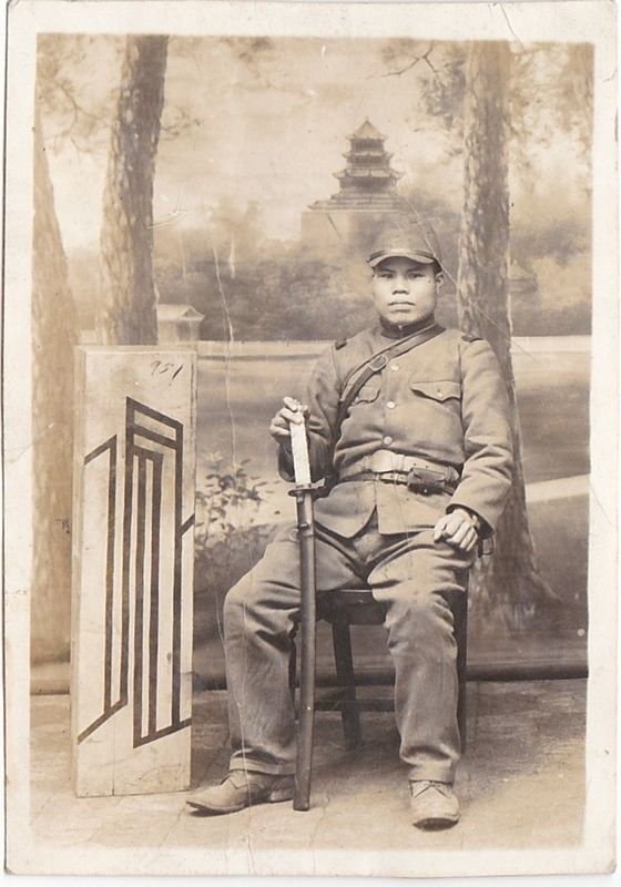 Japanese Soldier Holding a Sword Photo