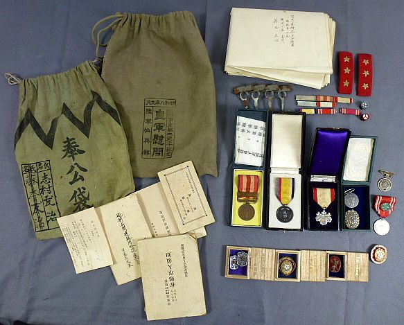 Large Group of Japanese Soldier's Medals and Documents